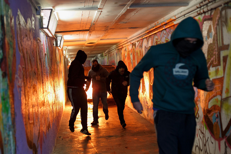 . Protesters run away from a bin that they set fire to in an undergrounf passage during a protest against the government\'s education reforms and cutbacks in university grants and staffing in Campus Ciudad Universitaria on March 26, 2014 in Madrid, Spain. The students began occupying a campus building at Ciudad Universitaria several days ago in protest against the governments\' cuts. Today, they were removed from the premises by police, who made fifty arrests, after the University requested their assistance.  (Photo by Pablo Blazquez Dominguez/Getty Images)