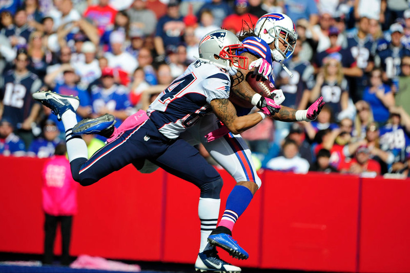 . New England Patriots wide receiver Brian Tyms (84) catches a pass for a touchdown as he is defended by Buffalo Bills\' Stephon Gilmore (24) during the first half of an NFL football game Sunday, Oct. 12, 2014, in Orchard Park, N.Y. (AP Photo/Gary Wiepert)