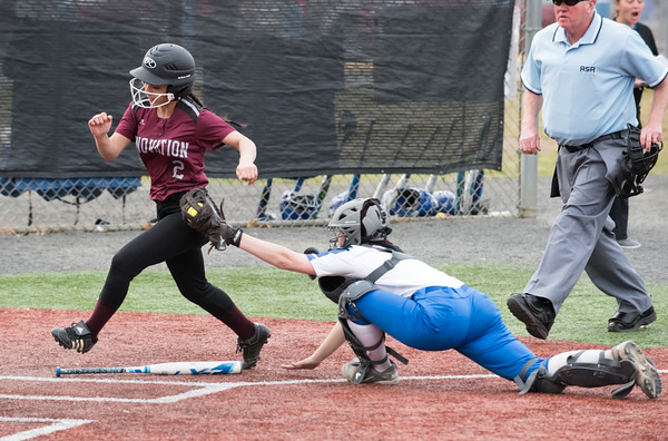 04/24/18 Wesley Bunnell | Staff Innovation softball defeated Plainville 7-6 in extra innings on Tuesday afternoon at Plainville. Makayla Caron (2) tags out Innovation runner Angelica Albelo (2).