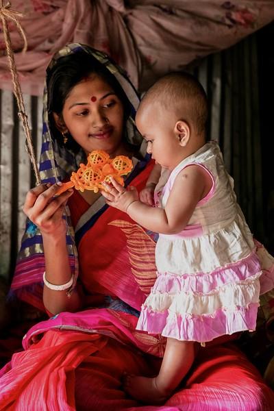 0074-0084A village mother Songita Rani (20) giving time to play with her 6-month-old baby Anusree inside home.Atkhali Village, Dakua Union Golachepa, Potuakhali. Bangladesh.Photo Credit: b.a.sujaN / Map / WRA