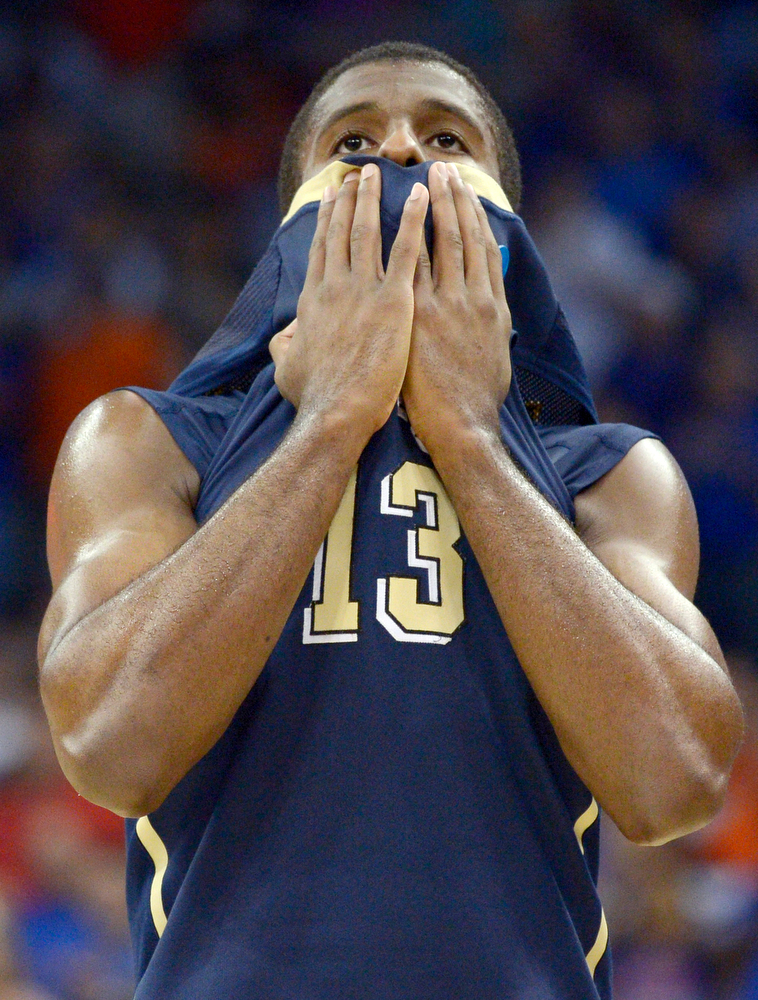 . Pittsburgh guard Josh Newkirk (13) walks off the court after losing 61-45 to Florida in a third-round game atn the NCAA college basketball tournament  Saturday, March 22, 2014, in Orlando, Fla.  (AP Photo/Phelan M. Ebenhack)