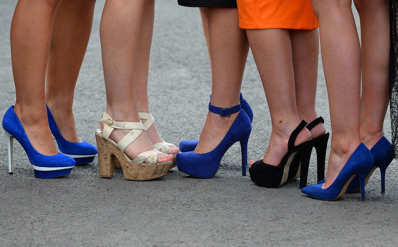 . A picture shows the high-heeled shoes of racegoers during Ladies Day, the second day of the Grand National Meeting horse racing event at Aintree Racecourse in Liverpool, north-west England on April 5, 2013. The annual three day meeting culminates in the Grand National which is run over a distance of four miles and four furlongs (7,242 metres), and is the biggest betting race in the United Kingdom.  ANDREW YATES/AFP/Getty Images