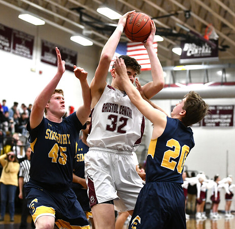 1/17/2020 Mike Orazzi | Staff Bristol Central's Donovan Clingan (32) and Simsbury's Sam Scott (45) and Dan O'Connor (20) at Bristol Central Friday night.