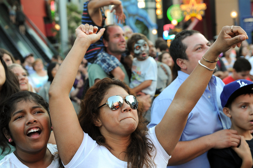 . People have fun during a DJ performance at 5 Towers at Universal CityWalk. Friday, July 6, 2013. (Michael Owen Baker/L.A. Daily News)