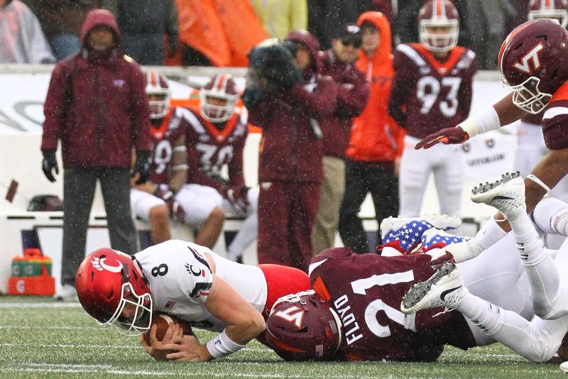 Cincinnati quarterback #8 Hayden Moore is tackled by Virginia Tech #21 Reggie Floyd