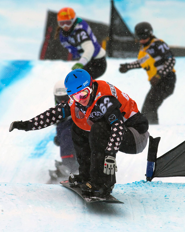 . In this photo provided by Nathan Bilow Photography, Canada\'s Maelle Ricker leads her heat in the women\'s snowboard cross World Cup team event in Telluride, Colo., on Saturday, Dec. 15, 2012. Ricker and teammate Dominique Maltais placed first in Saturday\'s race. (AP Photo/Nathan Bilow)