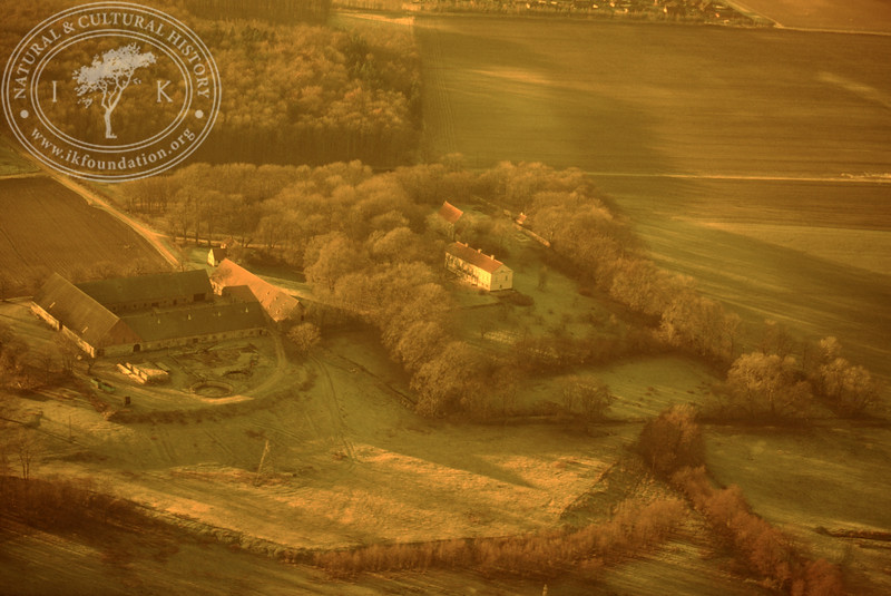 Araslöv manor house and church with farmland. Experimentally photographed with yellow filter (19 November, 1988). | LH.0236