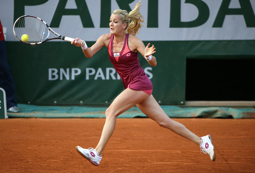 . Poland\'s Agnieszka Radwanska hits a return to Serbia\'s Ana Ivanovic during a French tennis Open round of 16 match at the Roland Garros stadium in Paris on June 2, 2013.   KENZO TRIBOUILLARD/AFP/Getty Images