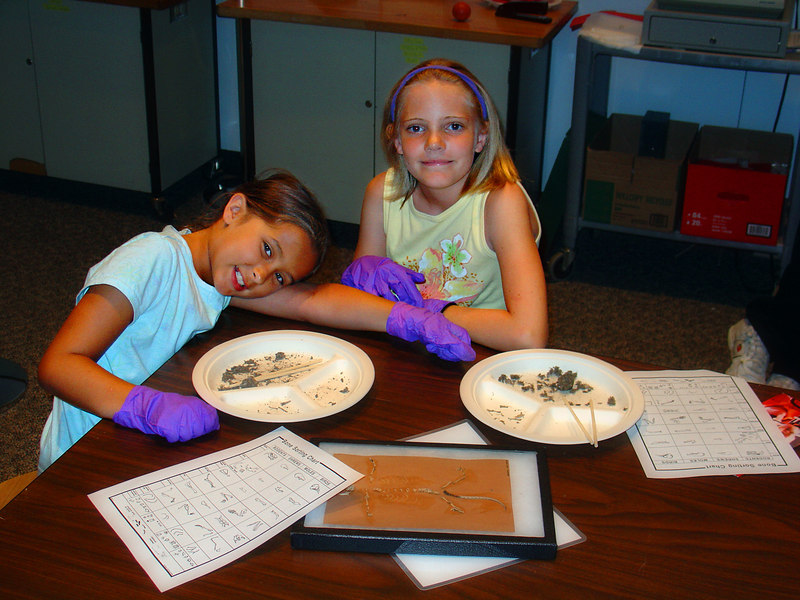 Daniela and Emily and a favorite activity - dissecting owl pellets!