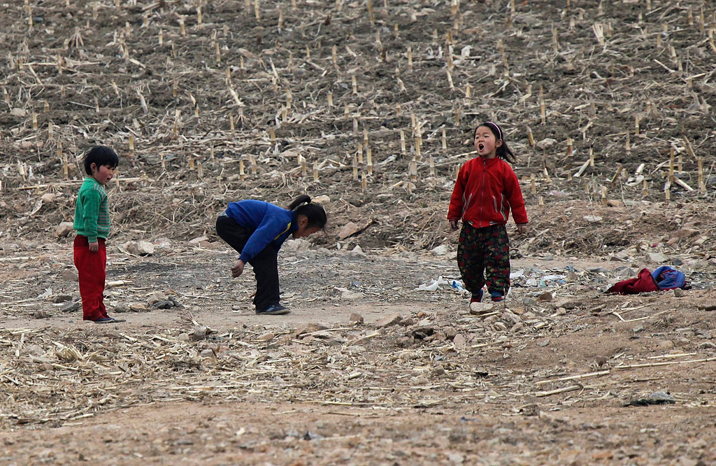 ". North Korean children play on the banks of Yalu River, about 100 km (62 miles) from the North Korean town of Sinuiju, opposite the Chinese border city of Dandong, April 16, 2013. North Korea issued new threats against South Korea on Tuesday, vowing ""sledge-hammer blows\"" of retaliation if South Korea did not apologise for anti-North Korean protests the previous day when the North was celebrating the birth of its founding leader. REUTERS/Jacky Chen"