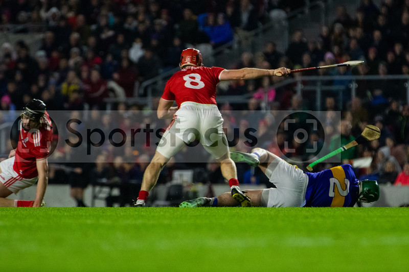 Tipperary's John O'Dwyer takes a hit from Cork's Bill Cooper