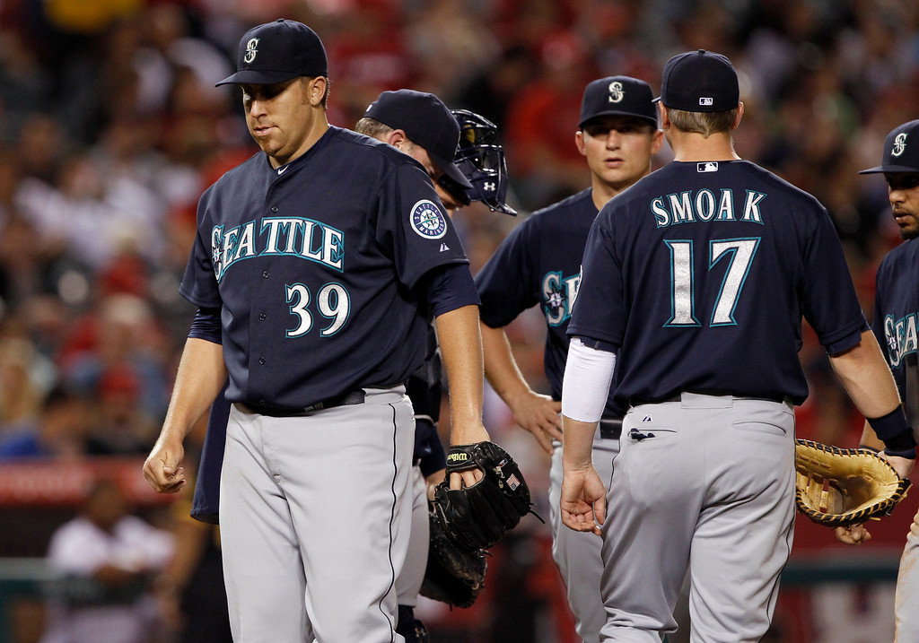 . Seattle Mariners starting pitcher Aaron Harang (39) is lifted  in the fourth inning against the Los Angeles Angels during a baseball game Tuesday, May 21, 2013 in Anaheim.    (AP Photo/Alex Gallardo)