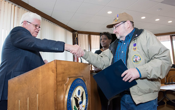 10/29/18 Wesley Bunnell | Staff Congressman John Larson (CT-01) presented 14 Vietnam Veterans with Vietnam Veteran lapel pin's during a ceremony at Berlin Town Hall in commemoration of the 50th anniversary of the Vietnam War. Congressman Larson (CT-01) shakes hands with Vietnam Vet Richard Kotek.