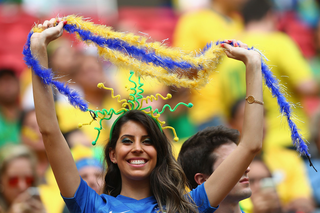. A Brazil fan enjoys the atmosphere prior to the 2014 FIFA World Cup Brazil Group A match between Cameroon and Brazil at Estadio Nacional on June 23, 2014 in Brasilia, Brazil.  (Photo by Clive Brunskill/Getty Images)