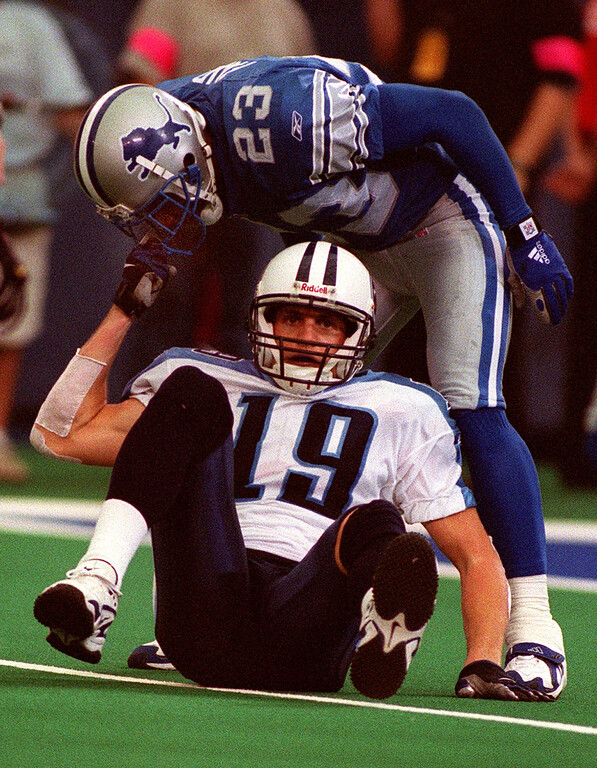 . Detroit Lions corner back Terry Fair (top) drew a penalty for unsportsmanlike conduct after tauting downed Tenessee Titan wide receiver Drew Bennett in the Lions 27-24 loss at the Pontiac Silverdome Sunday.