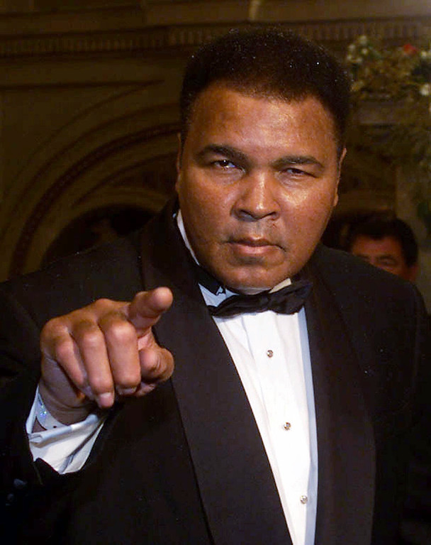 . Former boxing champion Muhammad Ali points to the photographers upon his arrival , Friday, Nov. 19 1999 for the World Sports Award of the Century Gala at the state opera in Vienna. During the Gala Evening eleven winners will be named in the following disciplines: athletics, ball sports, soccer, contact sports, motor sport, water sports and winter sports. (AP Photo/Martin Gnedt)