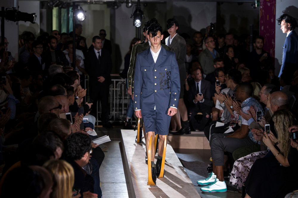 . Models wear creations by Japanese designer Rei Kawakubo, as part of Comme des Garcons men\'s Spring-Summer 2015 fashion collection, presented in Paris, Friday, June 27, 2014. (AP Photo/Zacharie Scheurer)