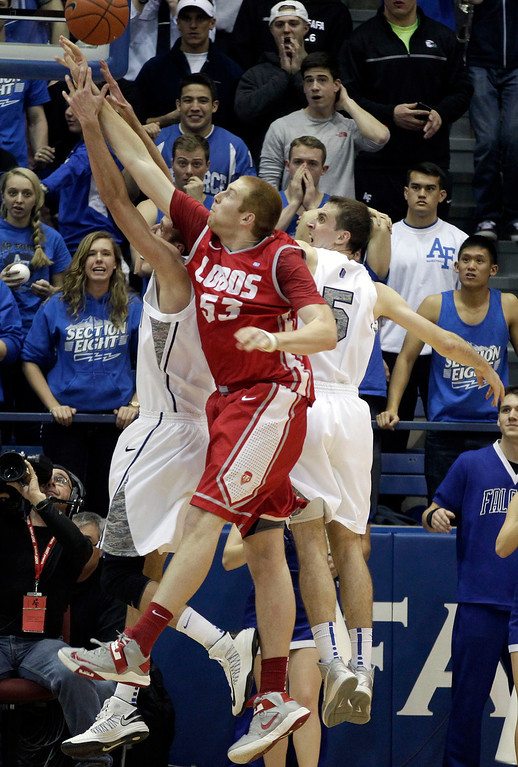 . Air Force and New Mexico players jump for a rebound during the second half of an NCAA college basketball game in Air Force Academy, Colo., Saturday, March 9, 2013. Air Force defeated New Mexico 89-88. (AP Photo/Brennan Linsley)