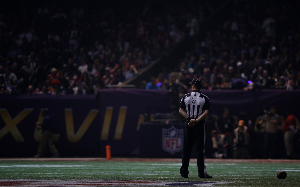 . Field judge Craig Wrolstad stands on the field after the lights went out during the second half of NFL Super Bowl XLVII football game Sunday, Feb. 3, 2013, in New Orleans. (AP Photo/Matt Slocum)