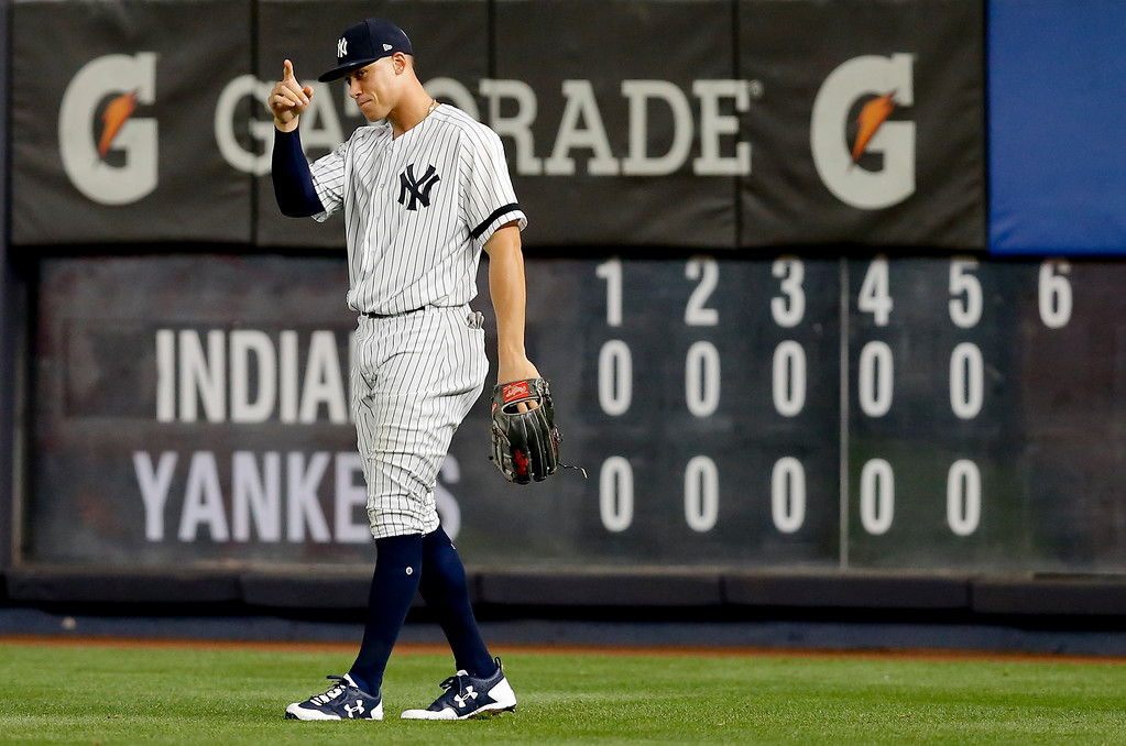 . New York Yankees right fielder Aaron Judge points to pitcher Masahiro Tanaka after making a catch at the wall on a line drive hit by Cleveland Indians\' Francisco Lindor during the sixth inning in Game 3 of baseball\'s American League Division Series, Sunday, Oct. 8, 2017, in New York. (AP Photo/Kathy Willens)