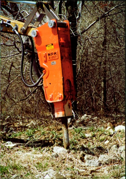 NPK E207 hydraulic hammer on Cat backhoe - one piece bracket at NPKCE 4-20-01 (2).JPG