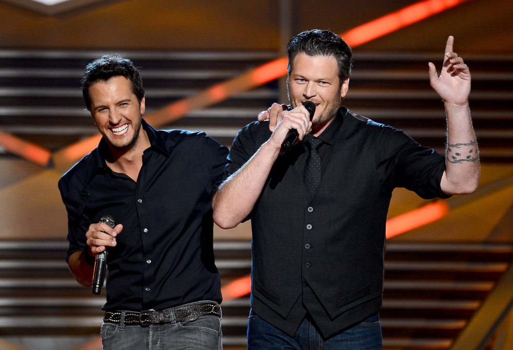 . Hosts Luke Bryan (L) and Blake Shelton speak onstage during the 48th Annual Academy of Country Music Awards at the MGM Grand Garden Arena on April 7, 2013 in Las Vegas, Nevada.  (Photo by Ethan Miller/Getty Images)