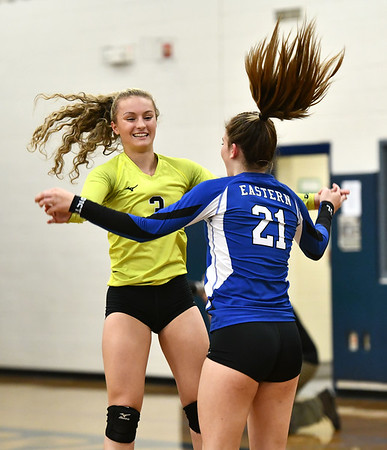 10/23/2019 Mike Orazzi | StaffrBristol Eastern's Rebecca Bender (3) and Alexandra Shorette (21) against RHAM during girls volleyball at Bristol Eastern on Wednesday night. r