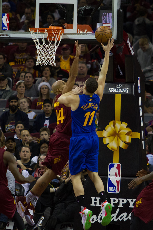 . Richard Jefferson (24) of the Cleveland Cavaliers attempts to block the shot of the Golden State Warriors\' Klay Thompson (11) during an NBA game at the Quicken Loans Arena on Christmas day.  The Cavs defeated the Warriors 109-108.  Michael Johnson - The News Herald