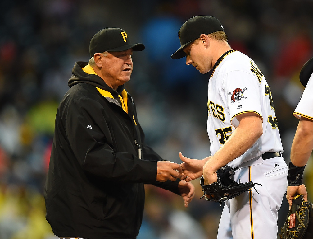 . PITTSBURGH, PA - MAY 21:  Manager Clint Hurdle removes Mark Melancon #35 of the Pittsburgh Pirates from the game after giving up two runs during the ninth inning against the Colorado Rockies on May 21, 2016 at PNC Park in Pittsburgh, Pennsylvania.  (Photo by Joe Sargent/Getty Images)