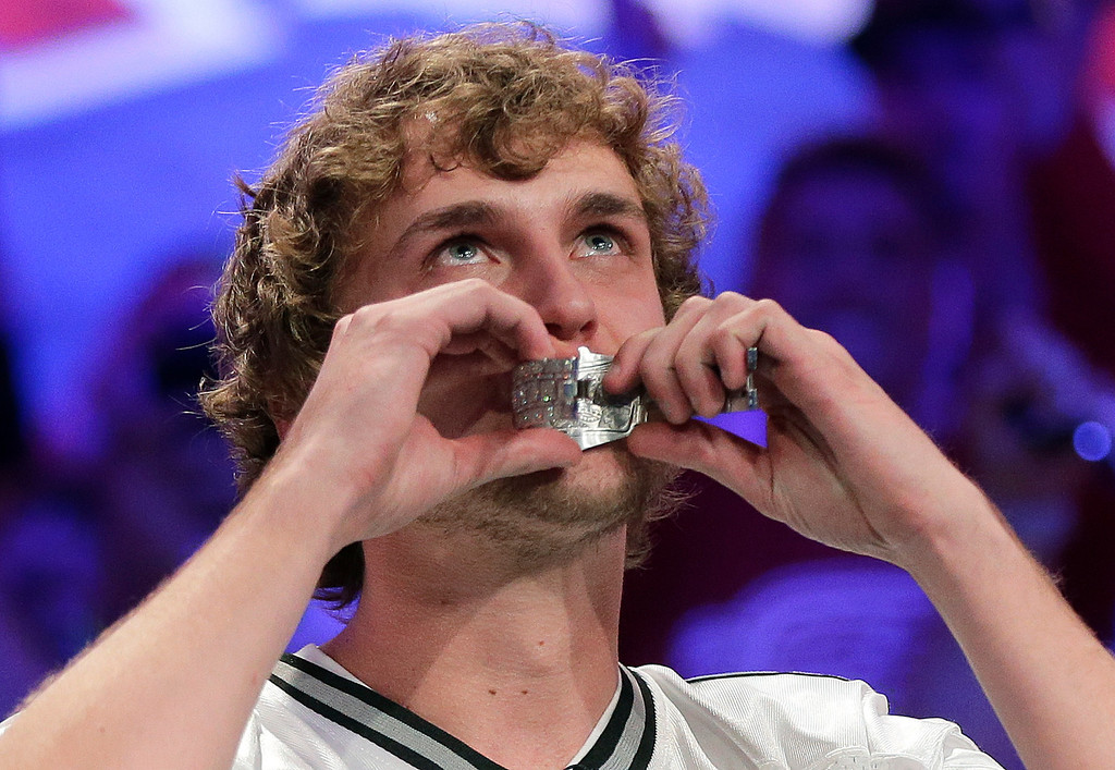 . Ryan Riess kisses the championship bracelet after defeating Jay Farber for the $8.4 million payout in the World Series of Poker Final Table, Tuesday, Nov. 5, 2013, in Las Vegas. (AP Photo/Julie Jacobson)