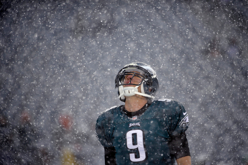 . Philadelphia Eagles\' Nick Foles warms up as snow falls before an NFL football game against the Detroit Lions, Sunday, Dec. 8, 2013, in Philadelphia. (AP Photo/Matt Rourke)