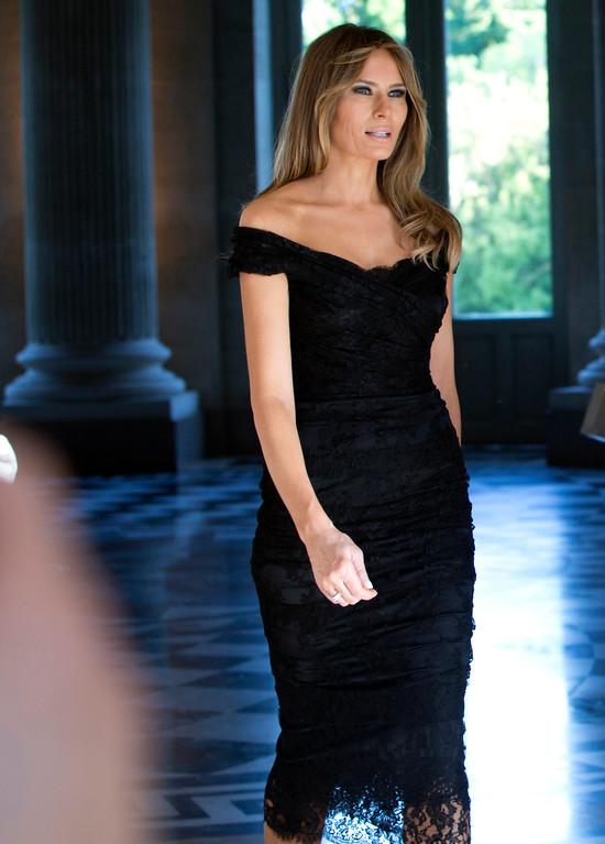 . FILE - In this Thursday, May 25, 2017 file photo, Melania Trump walks prior to a group photo during the spouse and partner program at the Royal Palace of Laeken, near Brussels. Trump wore a steady wardrobe of mostly black during President Donald Trump\'s overseas tour, including a prim black lace dress with a matching mantilla headcover that she wore to meet Pope Francis and a dark jacket with golden detailing on the cuff and collar that she wore for her arrival in Italy, both by Milan designers Domenico Dolce and Stefano Gabbana. (AP Photo/Virginia Mayo, File)