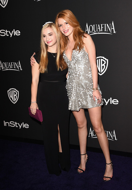. Actress Bella Thorne (R) and guest attend the 2015 InStyle And Warner Bros. 72nd Annual Golden Globe Awards Post-Party at The Beverly Hilton Hotel on January 11, 2015 in Beverly Hills, California.  (Photo by Jason Merritt/Getty Images)