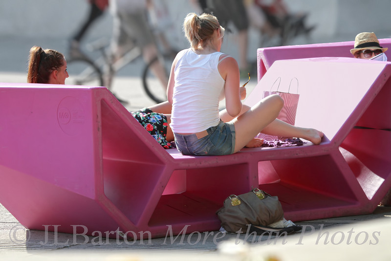 Seats in the City 2012-08-15  These so-called 'Enzos' have been around for a decade, giving people a place to stretch out and relax.  They are in the courtyards of the Museums Quarter in Vienna.  This year's color is 'candy shop pink'.