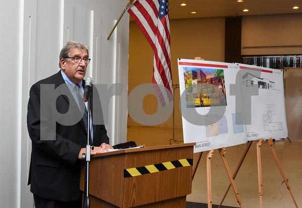 10/19/17 Wesley Bunnell | Staff CMHA held their annual meeting at their new location on Main St. across from Central Park in downtown New Britain. President of CMHA Ray Gorman addresses the crowd as plans for the final look of the new building are shown.