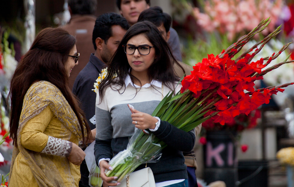 . People buy flowers at a flower market, to celebrate Valentine\'s Day, in Islamabad, Pakistan, Tuesday, Feb. 14, 2017. A Pakistani judge has banned Valentine\'s Day celebrations in the country\'s capital, saying they are against Islamic teachings. A court official says the judge ruled on a petition seeking to ban public celebrations. Islamist and rightwing parties in Pakistan view Valentine\'s Day as a vulgar Western import. (AP Photo/B.K. Bangash)