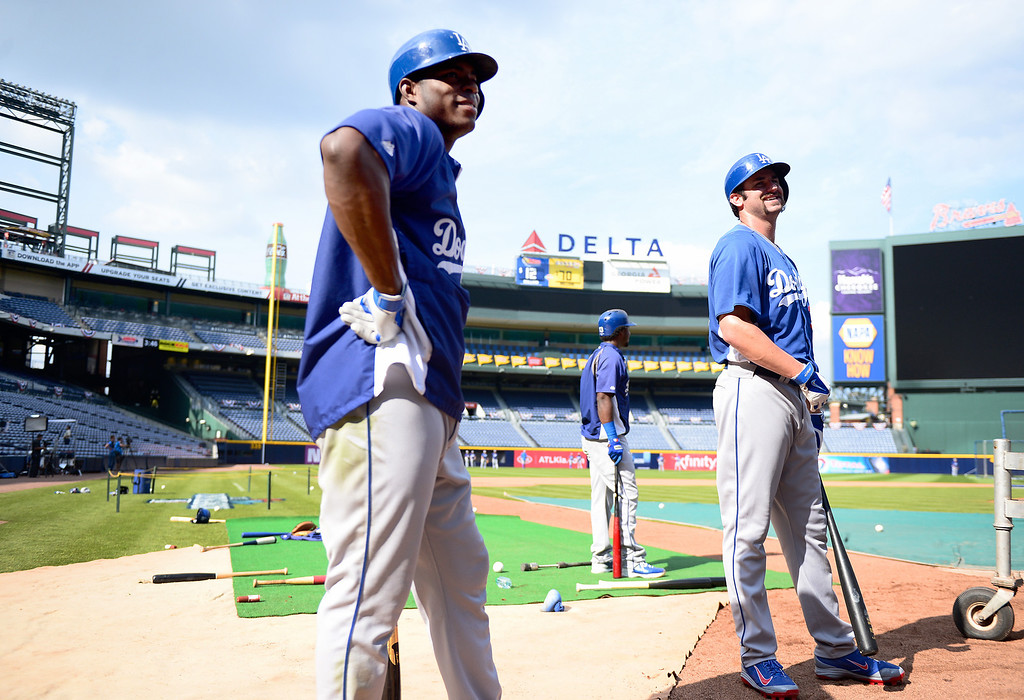 . Los Angeles Dodgers\' Yasiel Puig and Scott Van Slyke are in line to bat Wednesday, October 2, 2013 as they get ready for the first playoff game against the Atlanta Braves Thursday at Turner Field in Atlanta, Georgia. (Photo by Sarah Reingewirtz/Pasadena Star- News)