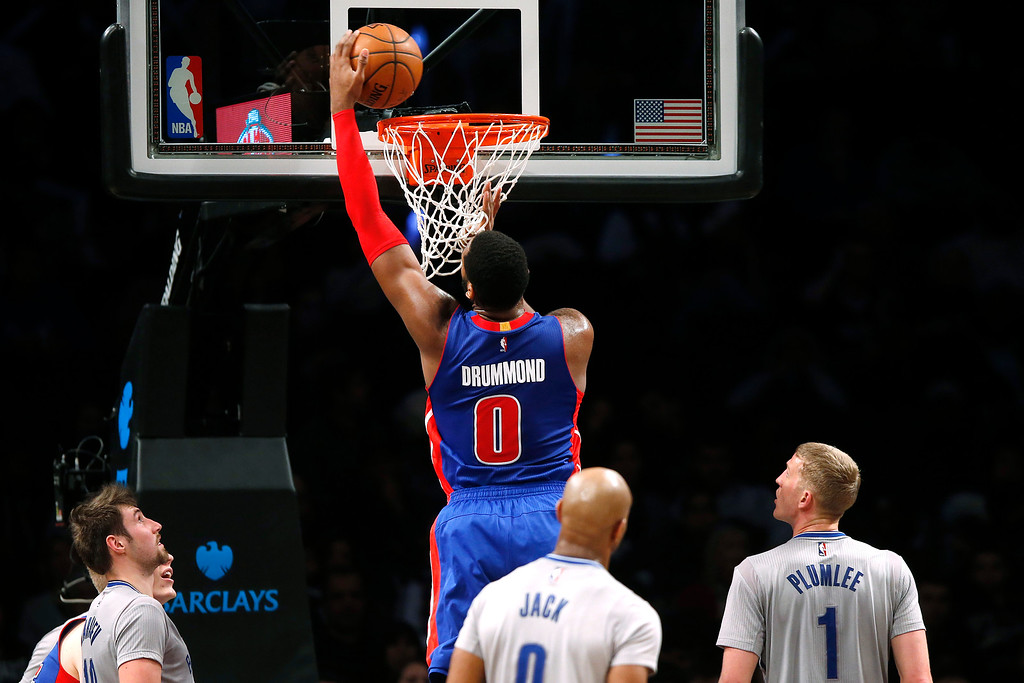 . Detroit Pistons\' Andre Drummond (0) dunks against the Brooklyn Nets during the third quarter of an NBA basketball game Sunday, Dec. 21, 2014, in New York.  Brooklyn beat Detroit 110-105. (AP Photo/Jason DeCrow)