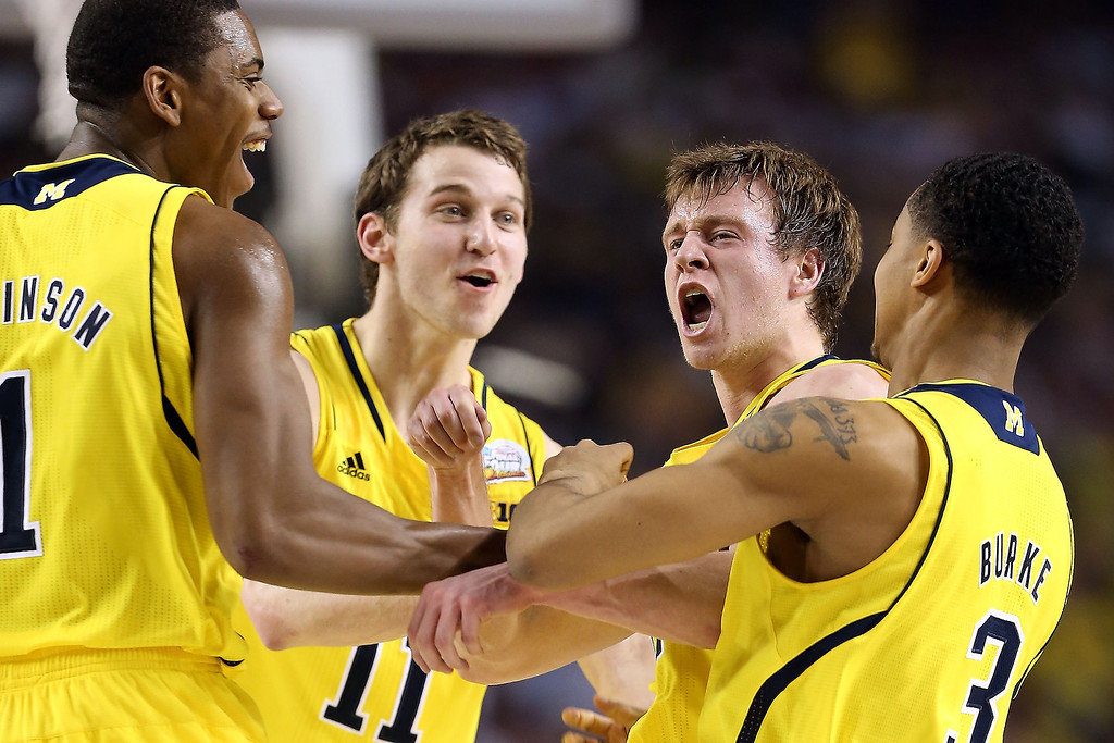 . (From left) Glenn Robinson III #1, Nik Stauskas #11, Spike Albrecht #2 and Trey Burke #3 of the Michigan Wolverines celebrate a play in the first half against the Louisville Cardinals during the 2013 NCAA Men\'s Final Four Championship at the Georgia Dome on April 8, 2013 in Atlanta, Georgia.  (Photo by Andy Lyons/Getty Images)