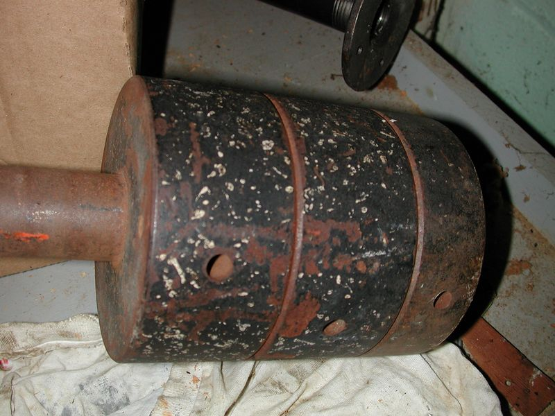 """Three Counterweights of the mount. It appears these weights are rusted quite a lot lenght-wise along the black & white paint. However much of this""""rust"""" is actually  the primer located underneath the paint. The dec. shaft has very apparent rust which will clean up fairly easily with a S.O.S or Brillo pad."""