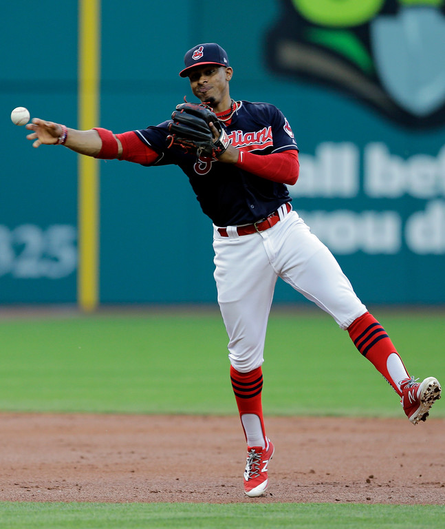 . Cleveland Indians\' Francisco Lindor throws to first base but not in time to get Kansas City Royals\' Whit Merrifield in the third inning of a baseball game, Friday, May 26, 2017, in Cleveland. (AP Photo/Tony Dejak)