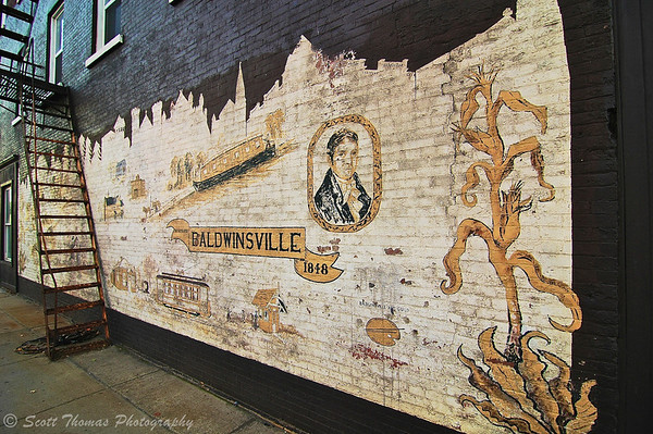 History mural painted in 1987 on the wall of the former Cozy Corner Cakery located at the Four Corners in Baldwinsville, New York.