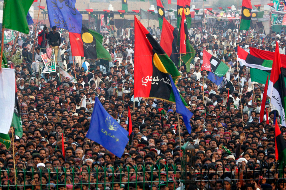 Description of . Pakistan Peoples Party (PPP) supporters gather to listen to the speech of Bilawal Bhutto Zardari, son of assassinated former Pakistani prime minister Benazir Bhutto, to launch his political career during the fifth anniversary of his mother's death, at the Bhutto family mausoleum in Garhi Khuda Bakhsh, near Larkana December December 27, 2012. Benazir Bhutto was killed in a gun and suicide bomb attack after an election rally in the city of Rawalpindi on December 27, 2007, weeks after she returned to Pakistan after years in self-imposed exile. REUTERS/Nadeem Soomro