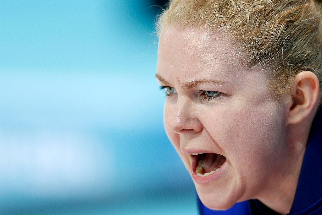 . Sweden\'s skip Margaretha Sigfridsson shouts instructions to her teammates during the women\'s curling competition against Denmark at the 2014 Winter Olympics, Thursday, Feb. 13, 2014, in Sochi, Russia. (AP Photo/Wong Maye-E)