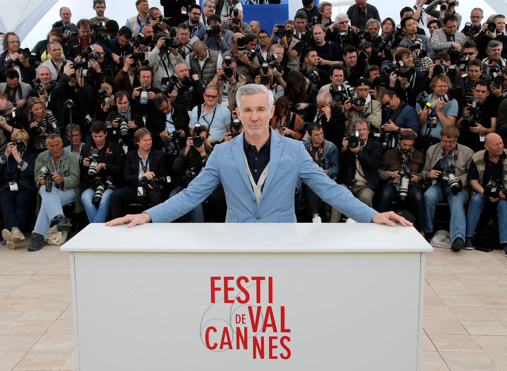 . Director Baz Luhrmann poses for photographers during a photo call for The Great Gatsby at the 66th international film festival, in Cannes, southern France, Wednesday, May 15, 2013. (AP Photo/Francois Mori)