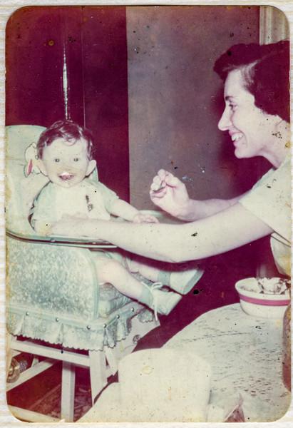 Elizabeth Brady feeding Paul Brady