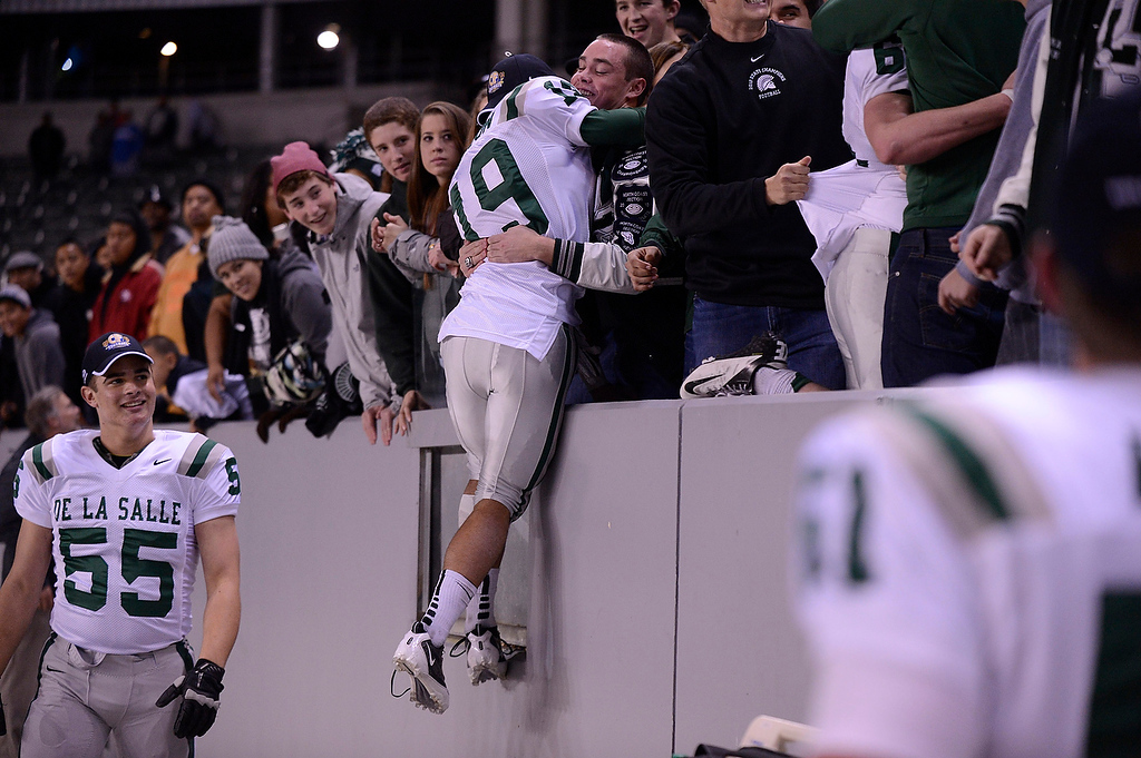 . De La Salle Spartans\' Richard Watson (19) is congratulated after defeating the Centennial Huskies in the Open Division during the 2012 CIF State Football Championship at Home Depot Center in Carson , Calif. on Saturday, Dec. 15, 2012. De La Salle defeated Centennial 48-28. (Jose Carlos Fajardo/Staff)