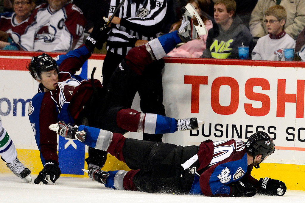 . DENVER, CO - MARCH 24: Ryan O\'Reilly (90) of the Colorado Avalanche upends teammate P.A. Parenteau (15) during the third period of action. The Colorado Avalanche lost to the Vancouver Canucks 3-2 at the Pepsi Center. (Photo by AAron Ontiveroz/The Denver Post)