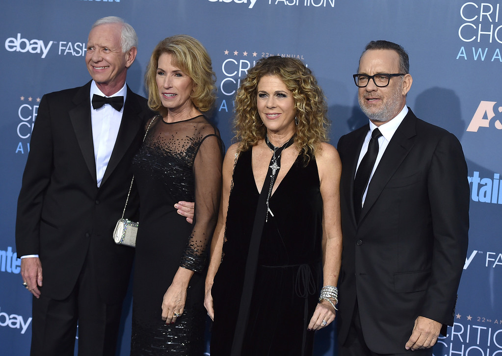 . Chesley Sullenberger, from left, Lorrie Sullenberger, Rita Wilson, and Tom Hanks arrive at the 22nd annual Critics\' Choice Awards at the Barker Hangar on Sunday, Dec. 11, 2016, in Santa Monica, Calif. (Photo by Jordan Strauss/Invision/AP)