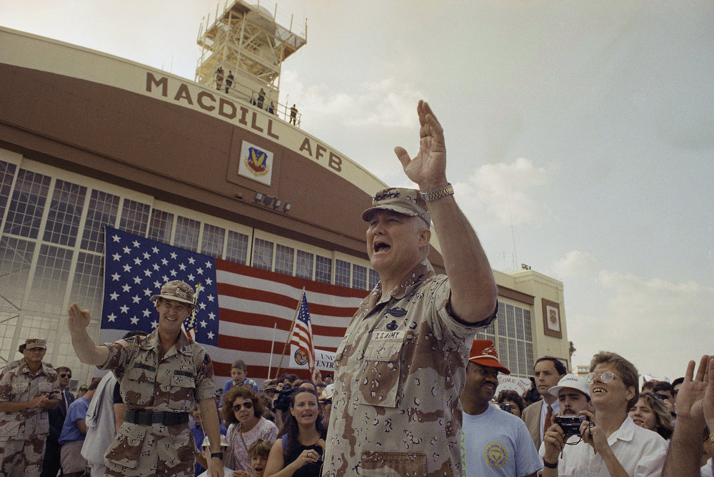 Description of . General H. Norman Schwarzkopf waves to the crowd after a military band played a song in his honor at welcome home ceremonies at MacDill Air Force Base on Sunday, April 22, 1991 in Tampa, Fla. Schwarzkopf returned to his U.S. Central Command after eight months in the Persian Gulf. (AP Photo/Lynne Sladky)